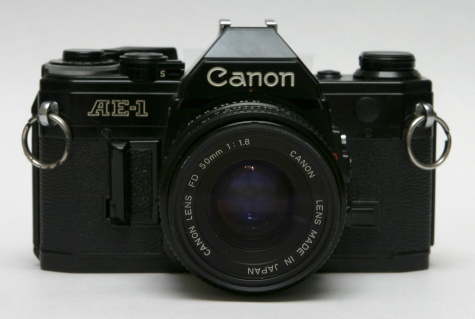 Canon_AE-1_front_with_50mm_lens.jpg